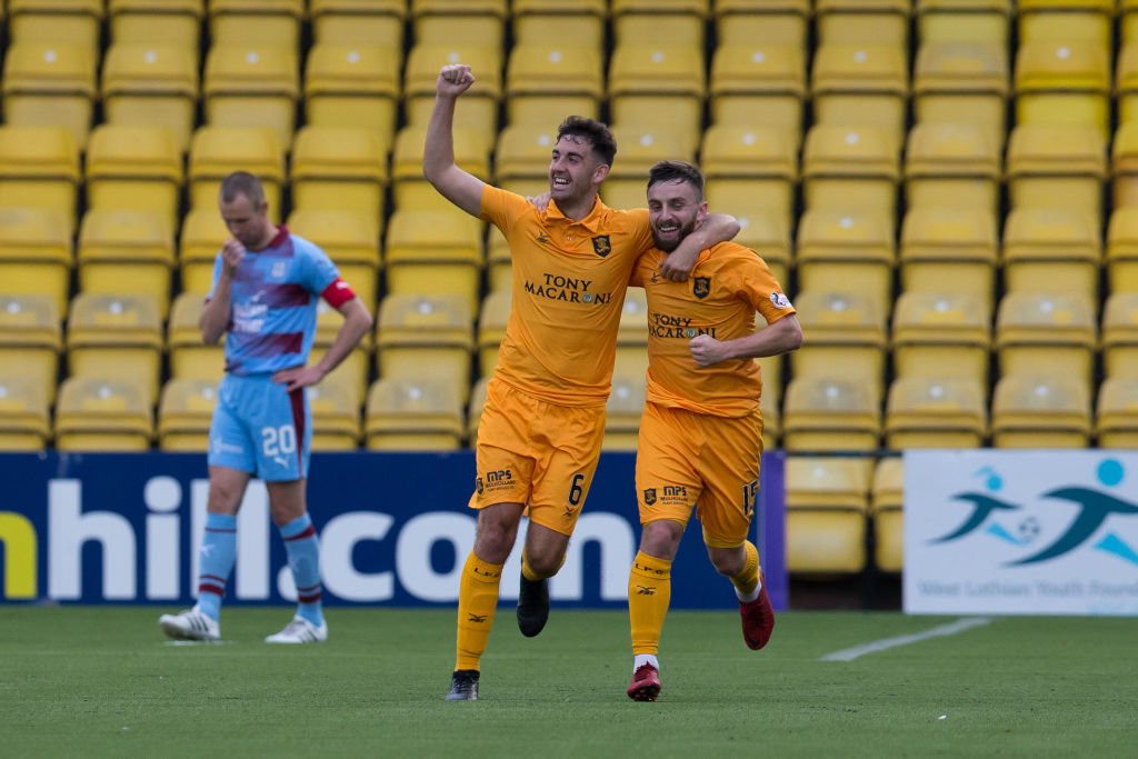20th October 2018, Tony Macaroni Arena, Livingston, Scotland; Ladbrokes Premiership football, Livingston versus Dundee; Steven Lawless of Livingston is congratulated after scoring for 3-0 by Shaun Byrne Rangers