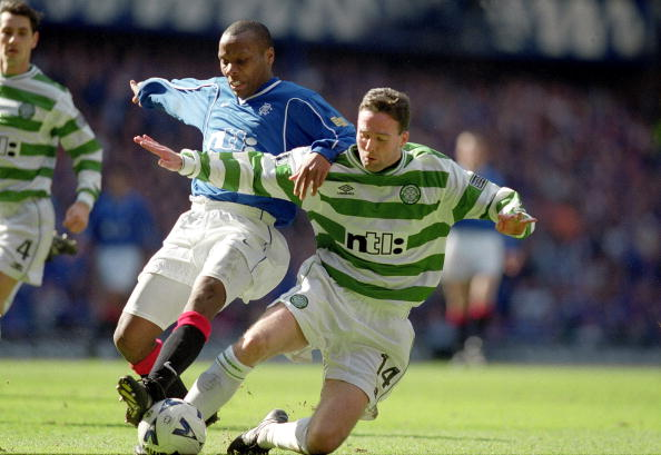 25 Mar 2000: Paul Lambert of Glasgow Celtic challenges Rod Wallace of Glasgow Rangers during the Scottish Premier Division match at Ibrox Stadium in Glasgow, Scotland. Glasgow Rangers won the match 4-0. Mandatory Credit: