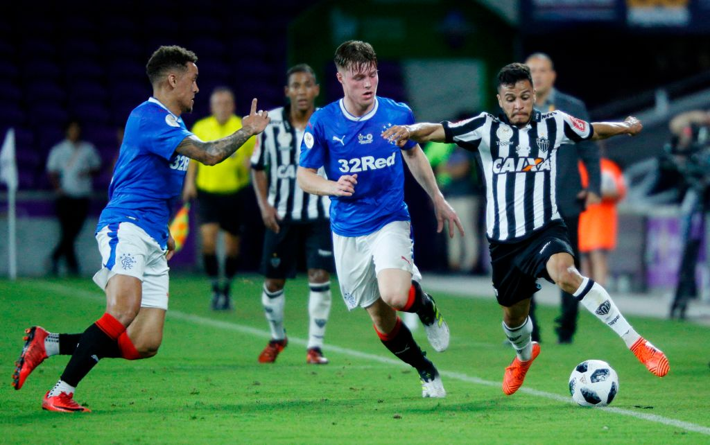 Thalis of Brazilian club Atletico Mineiro (R) is challenged by Aidan Wilson of Scottish club Rangers FC during their Florida Cup soccer game at Orlando City Stadium in Orlando, Florida on January 11, 2018. / AFP PHOTO / Gregg Newton / Gregg Newton
