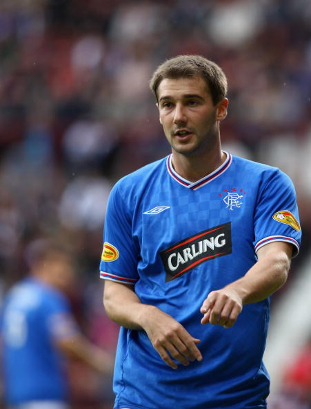 EDINBURGH, SCOTLAND - AUGUST 23: Kevin Thomson of Rangers in action during the Clydesdale Bank Scottish Premier league match between Hearts and Rangers at Tynecastle Park on August 23, 2009 in Edinburgh, Scotland.