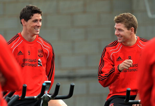 LIVERPOOL, ENGLAND - AUGUST 03: (THE SUN OUT) (L-R) Fernando Torres and Steven Gerrard of Liverpool chat during a training session at Melwood training ground on August 3, 2010 in Liverpool, England.