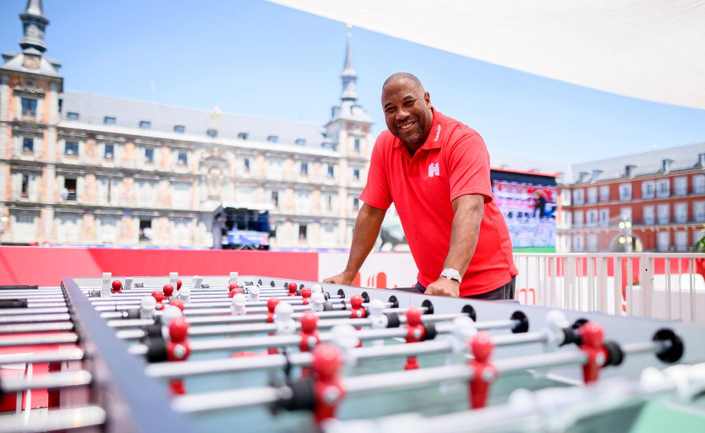 MADRID, SPAIN - MAY 31: John Barnes shows off his (table) football skills at the Hotels.com Champions Retreat ahead of the UEFA Champions League Final on May 31, 2019 in Madrid, Spain.