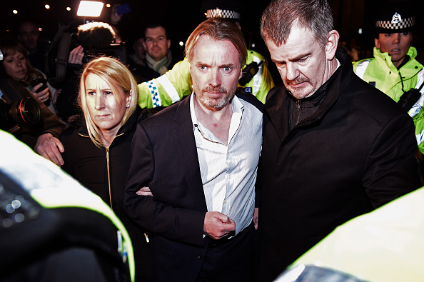 GLASGOW, SCOTLAND - NOVEMBER 28: Former Rangers owner Craig Whyte is surrounded by police after being released on bail following a court appearance at Glasgow Sheriff court on November 28, 2014 in Glasgow,Scotland. Whyte made no plea or declaration to the charge of fraud concerning the takeover of the Ibrox club in 2011.