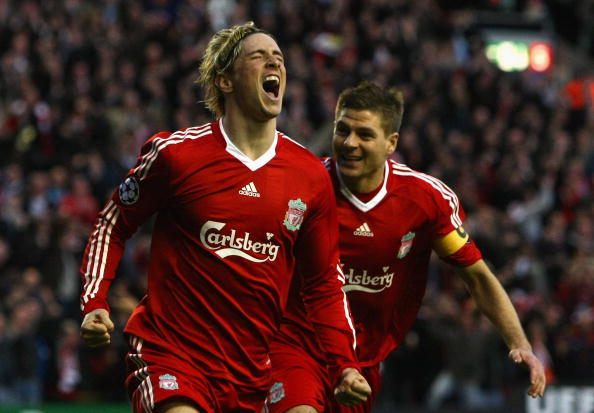 LIVERPOOL, UNITED KINGDOM - APRIL 08: Fernando Torres of Liverpool celebrates scoring the opening goal with team mate Steven Gerrard (R) during the UEFA Champions League Quarter Final First Leg match between Liverpool and Chelsea at Anfield on April 8, 2009 in Liverpool, England.  Rangers