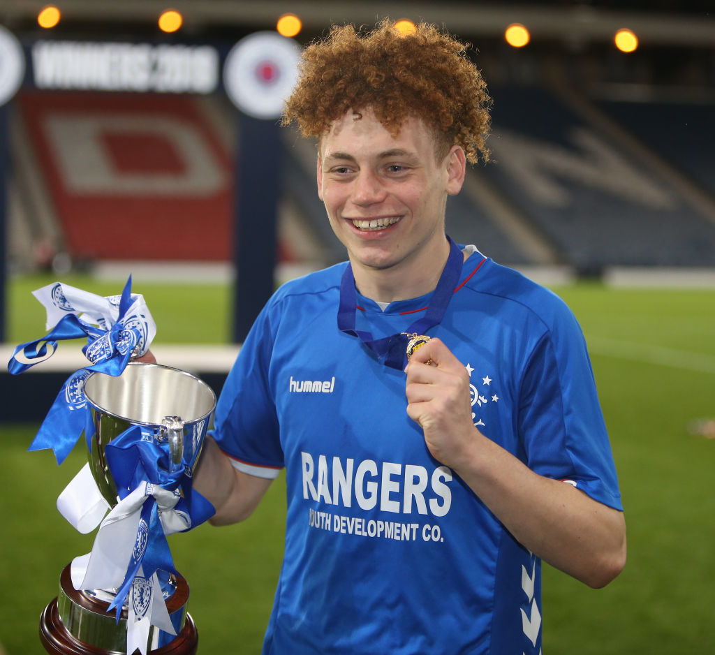 25th April 2019, Hampden Park, Glasgow, Scotland; Scottish FA Youth Cup Final, Celtic U18s versus Rangers U18s; Goalscorer Nathan Young-Coombes poses with the cup and his medal after Rangers won the Youth Cup