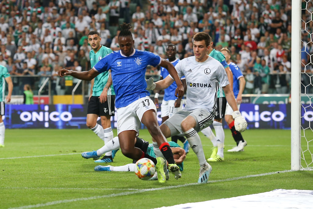 WARSAW, POLAND - AUGUST 22: Joe Aribo of Rangers FC competes with Radoslaw Majecki of Legia during the UEFA Europa League Play Off First Leg match between Legia Warsaw and Rangers FC on August 22, 2019 in Warsaw, Poland.