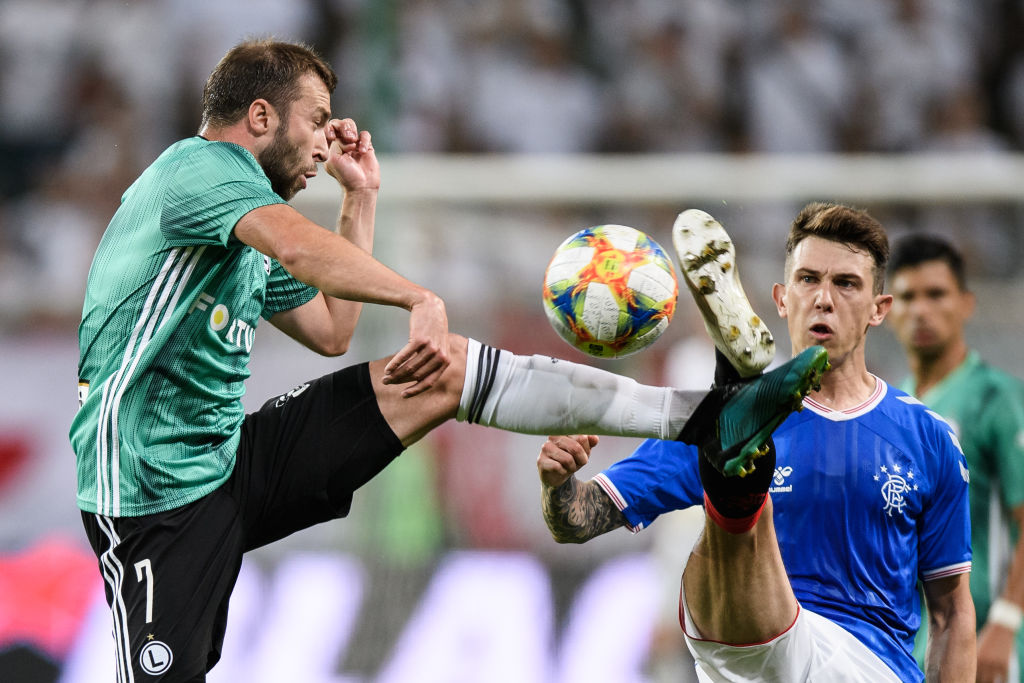 WARSAW, POLAND - AUGUST 22: Domagoj Antolic of Legia competes with Ryan Jack of Rangers FC during the UEFA Europa League Play Off First Leg match between Legia Warsaw and Rangers FC on August 22, 2019 in Warsaw, Poland.