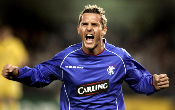 VILLARREAL, SPAIN: Glasgow Rangers' Danish Peter Lovenkrands celebrates his goal during their Champions league second leg football match at Madrigal stadium of Villarreal 07 March 2006. AFP PHOTO/ JOSE JORDAN