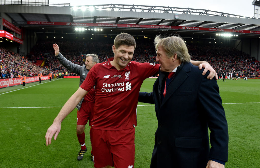 LIVERPOOL, ENGLAND - MARCH 23: (THE SUN OUT, THE SUN ON SUNDAY OUT) Steven Gerrard and Kenny Dalglish manager of Liverpool FC Legends laughing with each other at the end of the friendly match between Liverpool FC Legends and AC Milan Glorie at Anfield on March 23, 2019 in Liverpool, England.