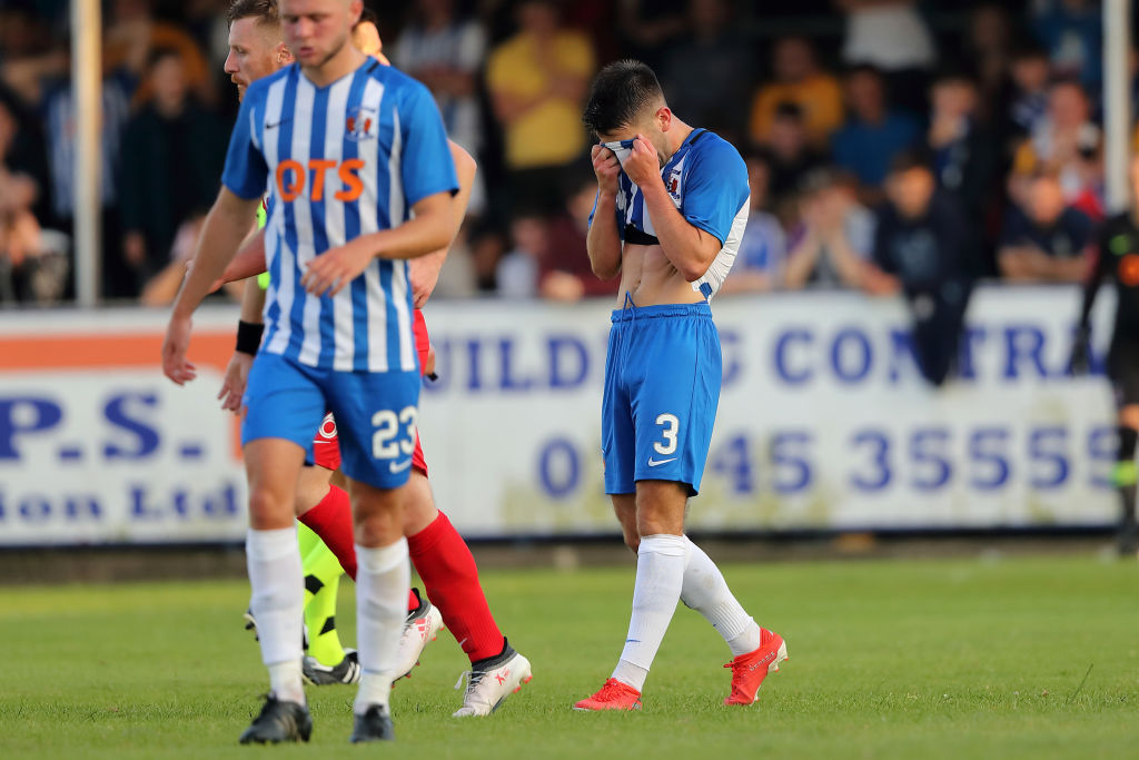 RHYL, WALES - JULY 11 : A dejected Greg Taylor of Kilmarnock after scoring am own goal to make it 1-0 during the UEFA Champions League Qualification first leg match between Connah's Quay Nomads and Kilmarnock on July 11, 2019 in Rhyl, Wales.