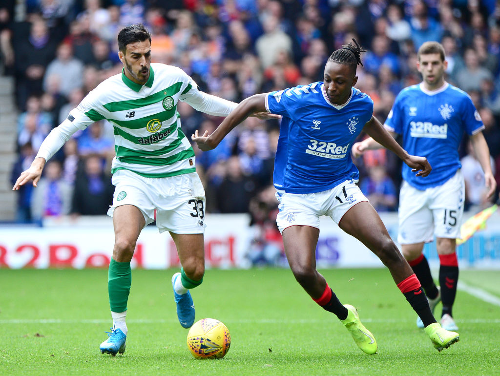 GLASGOW, SCOTLAND - SEPTEMBER 01: Hatem Elhamed of Celtic challenges for the ball with Joseph Aribo of Rangers FC during the Ladbrokes Premiership match between Rangers and Celtic at Ibrox Stadium on September 01, 2019 in Glasgow, Scotland.