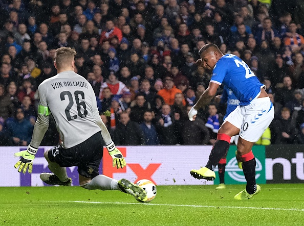 GLASGOW, SCOTLAND - DECEMBER 12: Young Boys goalkeeper David von Ballmoos saves from Alfredo Morelos (Rangers, blue, 20) during the UEFA Europa League group G match between Rangers FC and BSC Young Boys at Ibrox Stadium on December 12, 2019 in Glasgow, United Kingdom.