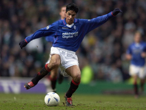 GLASGOW - MARCH 8: Mikel Arteta of Rangers runs with the ball during the Scottish Premier League match between Glasgow Celtic and Glasgow Rangers held on March 8, 2003 at Celtic Park, in Glasgow, Scotland. Celtic won the match 1-0.