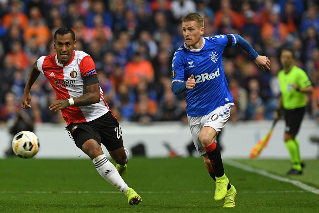 Renato Tapia keeps a close eye on Steven Davis during the clash between Rangers and Feyenoord at Ibrox.