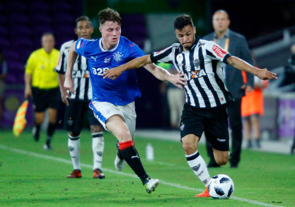Thalis of Brazilian club Atletico Mineiro (R) is challenged by Aidan Wilson of Scottish club Rangers FC during their Florida Cup soccer game at Orlando City Stadium in Orlando, Florida on January 11, 2018. / AFP PHOTO / Gregg Newton