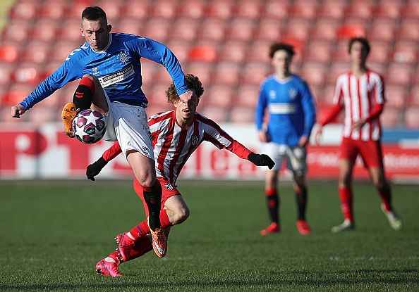 GLASGOW, SCOTLAND - FEBRUARY 12: Ciaran Dickson of Rangers vies with Mario Soriano of Athletico Madrid during the UEFA Youth League match between Rangers U19 and Atletico Madrid U19 at Firhill Park on February 12, 2020 in Glasgow, United Kingdom.