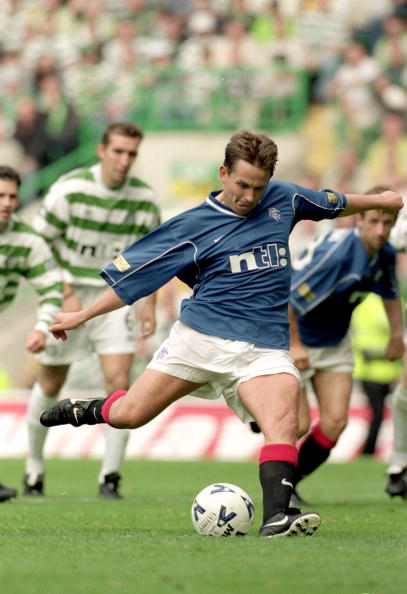 27 Aug 2000: Billy Dodds of Rangers scores from the penalty spot during the Scottish Premier League match against Celtic at Celtic Park, in Glasgow, Scotland. Celtic won the match 6-2. Mandatory Credit:
