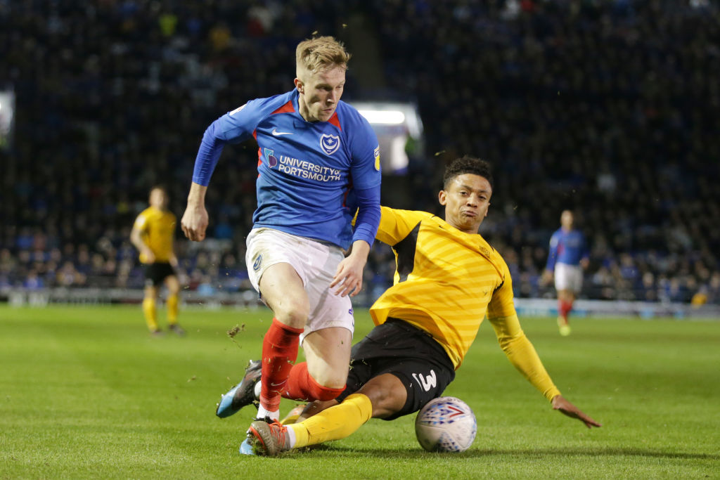 PORTSMOUTH, ENGLAND - NOVEMBER 05: Ross McCrorie of Portsmouth FC and Nathan Ralph of Southend United during the Sky Bet Leauge One match between Portsmouth and Southend United at Fratton Park on November 05, 2019 in Portsmouth, England.