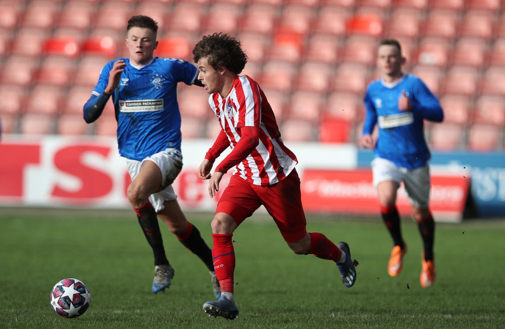GLASGOW, SCOTLAND - FEBRUARY 12: Rodrigo Riquelme of Athletico Madrid evades Nathan Patterson of Rangers during the UEFA Youth League match between Rangers U19 and Atletico Madrid U19 at Firhill Park on February 12, 2020 in Glasgow, United Kingdom.