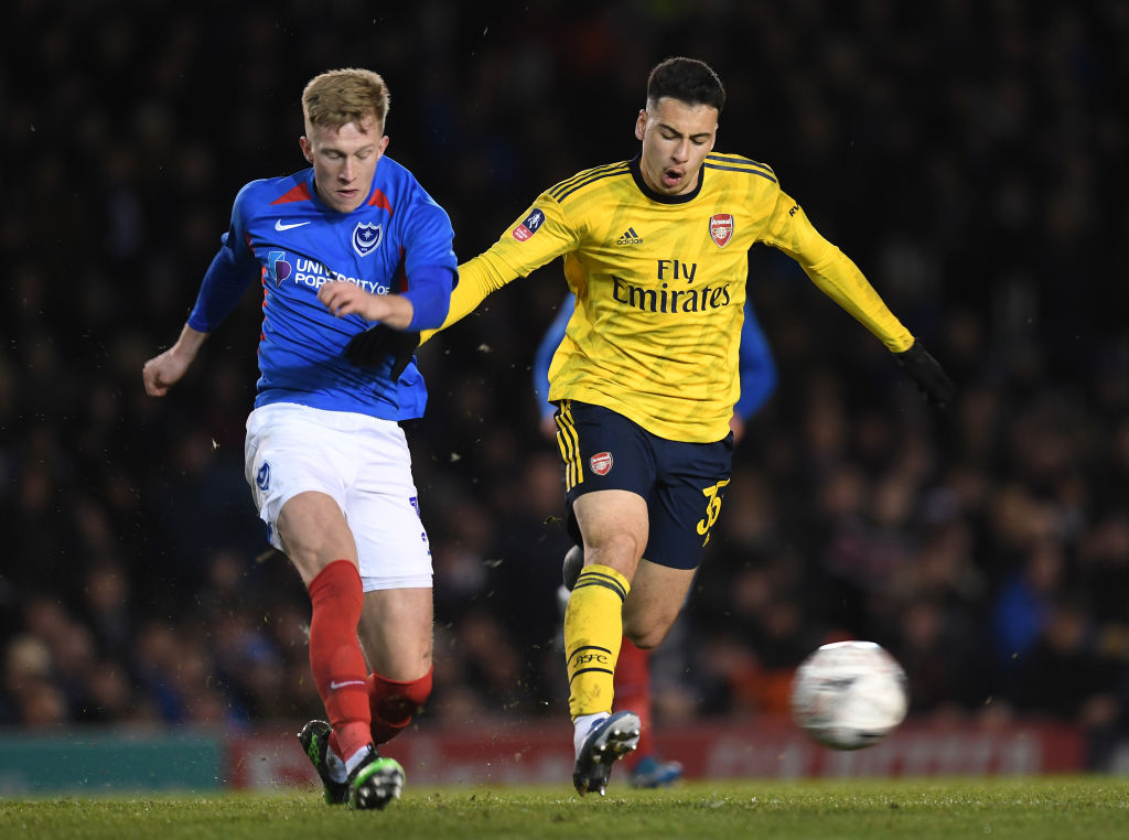 PORTSMOUTH, ENGLAND - MARCH 02: Gabriel Martinelli of Arsenal takes on Ross McCrorie of Portsmouth during the FA Cup Fifth Round match between Portsmouth and Arsenal at Fratton Park on March 02, 2020 in Portsmouth, England.