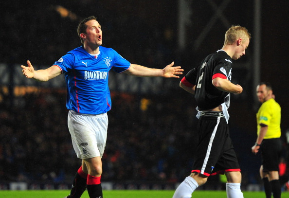 GLASGOW, SCOTLAND - NOVEMBER 6: Jon Daly of Rangers celebrates scoring his goal during the Scottish League One match between Rangers and Dunfermline at Ibrox Stadium on November 6, 2013 in Glasgow, Scotland.