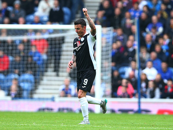 GLASGOW, SCOTLAND - OCTOBER 17 : Derek Lyle of Queen of the South celebrates scoring a goal during the first half of the Scottish Championship match between Glasgow Rangers FC and Queen of the South FC at Ibrox Stadium on October 17, 2015 in Glasgow, Scotland.