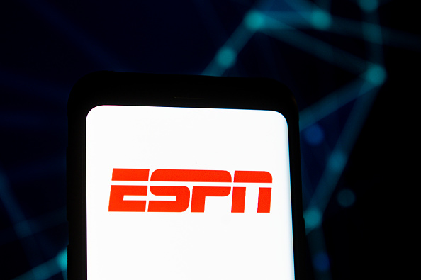 In this photo illustration an ESPN logo seen displayed on a
