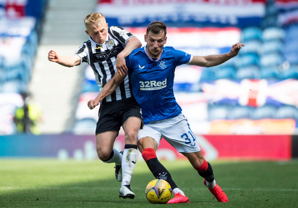 GLASGOW, SCOTLAND - AUGUST 09: Borna Barisic of Rangers holds off Cameron Macpherso of St. Mirren during the Ladbrokes Scottish Premiership match between Rangers FC and St. Mirren at Ibrox Stadium on August 09, 2020 in Glasgow, Scotland.