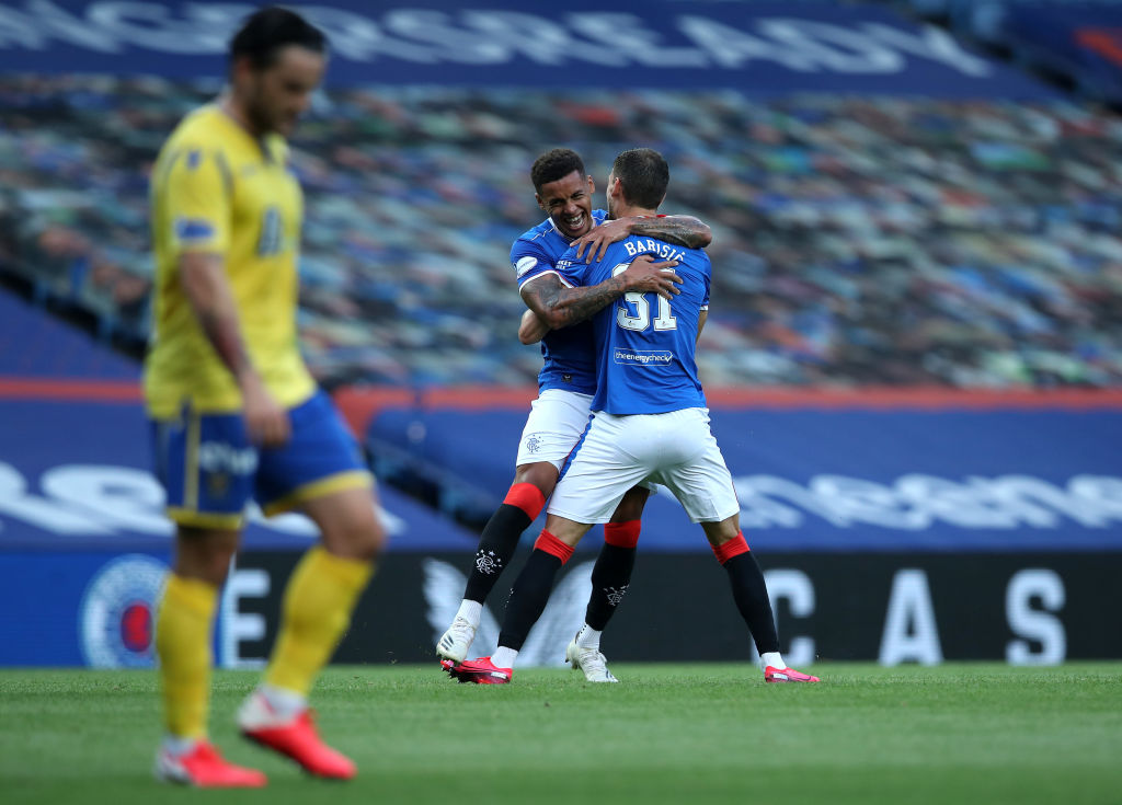 GLASGOW, SCOTLAND - AUGUST 12: Borna Barisic of Rangers FC celebrates with James Tavernier after scoring his team's first goal during the Ladbrokes Scottish Premiership match between Rangers and St. Johnstone at Ibrox Stadium on August 12, 2020 in Glasgow, Scotland.