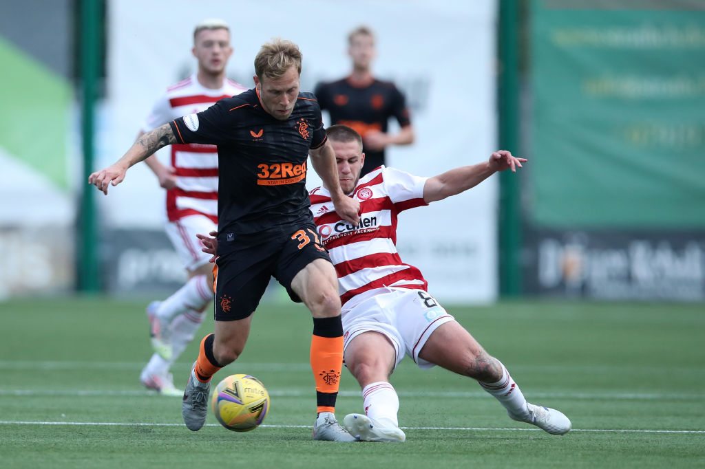 HAMILTON, SCOTLAND - AUGUST 29: Scott Arfield of Rangers FC battles for possession with Scott Martin of Hamilton during the Ladbrokes Scottish Premiership match between Hamilton Academical and Rangers at Hope CBD Stadium on August 29, 2020 in Hamilton, Scotland.