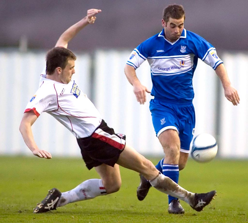 17/04/07 Sfl Div1.Clyde V St Johnstone (0-1).Broadwood - Cumbernauld.Clyde'S Craig Mckeown Slides In To Challenge Peter Macdonald On His Way Forward