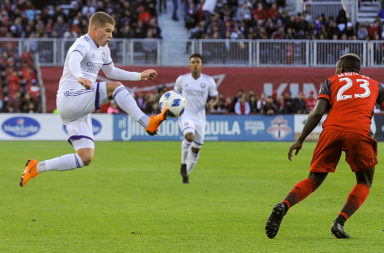 Chris Mueller (L) jumping for the ball during 2018 MLS